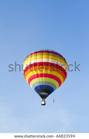 Hot air balloon against brilliant blue sky