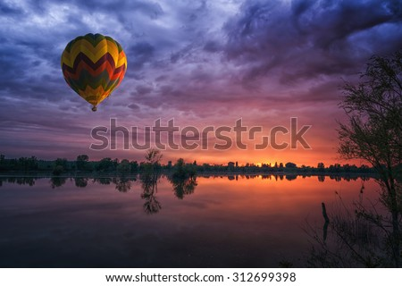 Stock Photo hot air balloon at sunset at the lake landscape natural background