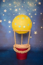 Hot air balloon decoration for a newborn babies photography in a photo studio
