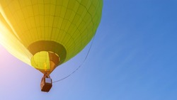 Hot air balloon flight view from below in the blue sky