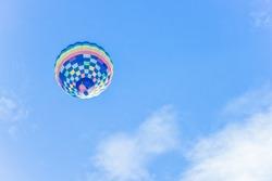 Hot air balloon flying against blue sky