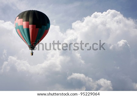 Hot Air Balloon Flying High in the Clouds
