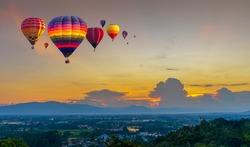 Hot air balloon flying over City landscape and Doi Saket mountain in Chiang Mai, Thailand