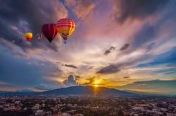 Hot air balloon flying over City landscape and Doi Suthep mountain in Chiang Mai, Thailand