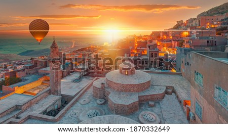 Hot air Balloon flying over Mardin old town - Mardin old town at twilight blue hour - Mardin, Turkey