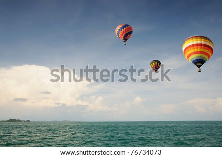 Hot air balloon flying over the sea