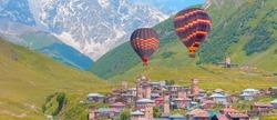 Hot air balloon flying over Ushguli - Mount Shkhara - Hot air balloon flying over Ushguli village - Upper Svaneti, Georgia