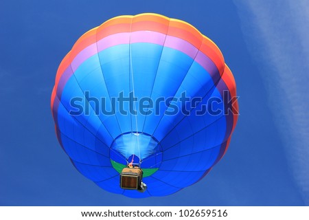 Hot air balloon hovering above.