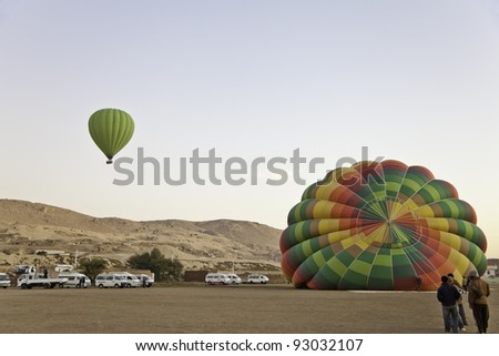 hot air balloon in front of valley of the king, luxor, egypt