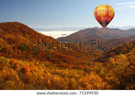 Hot Air Balloon Over Mountainous Autumn Landscape