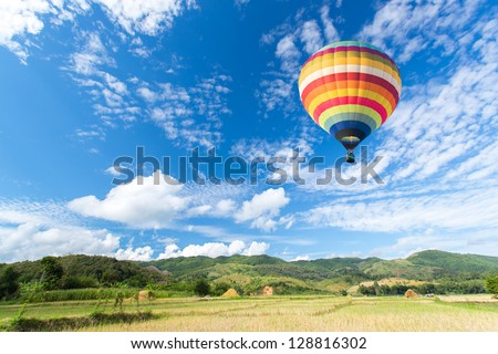 Hot air balloon over the field