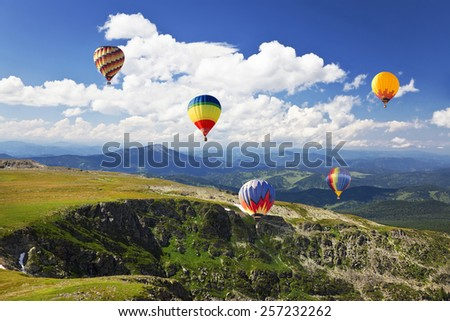 Hot air balloon over the mountain - Shutterstock ID 257232262