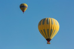 Hot air balloon profiled on deep blue sky
