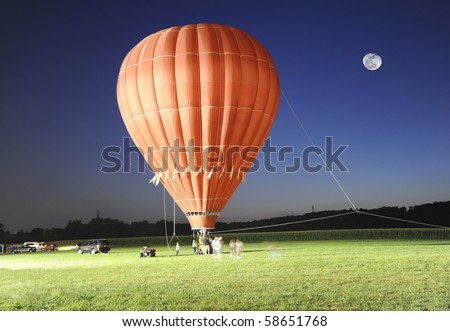 Hot air balloon ride after sunset on a full moon night