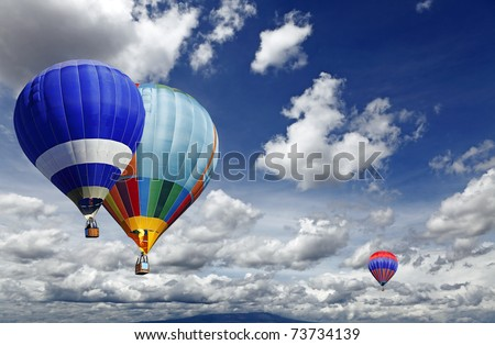 Hot air balloon sporting activity on a fresh blue day.