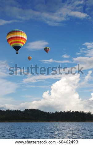 Hot air balloon travel over the lake