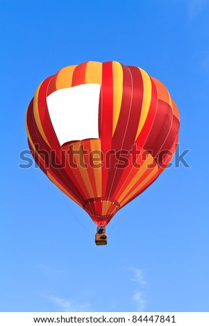 hot air balloon with blank banner over blue sky