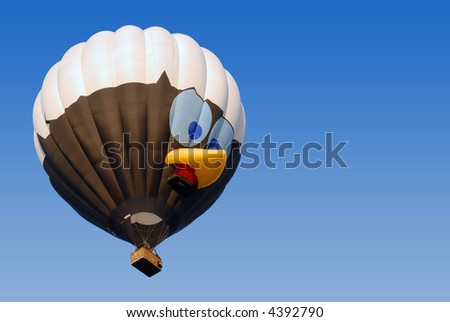 hot air balloon with special shape of little birdie in clear blue sky