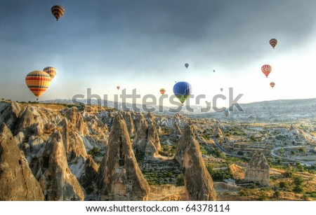 Hot air balloons above a gorgeous landscape