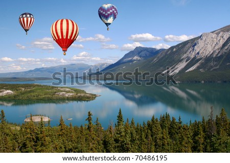 Hot Air Balloons Above Mountain Lake