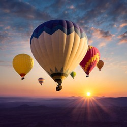 Hot air balloons above ultraviolet mountain silhouettes in golden sunlight. Sunrise in bright colors for your stories about travel dreams, active leisure or adventure.