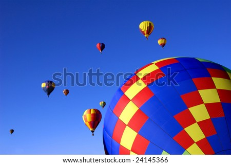 Hot air balloons against brilliant blue sky