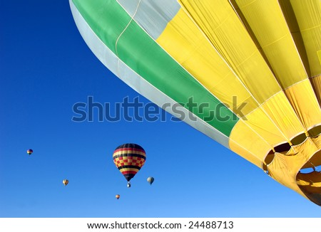 Hot air balloons against brilliant blue sky