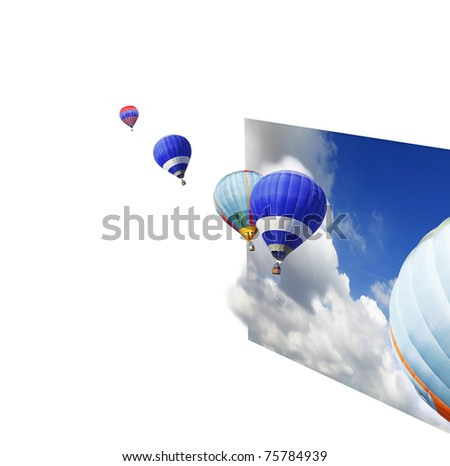Hot air balloons floating out of an imaginary sheet of dramatic blue cloudy sky with copyspace for text.
