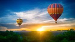 Hot Air balloons flying over forest landscape sunset vintage nature background
