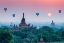Hot air balloons flying over the old temples in Bagan, Myanmar