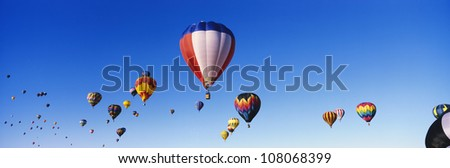 Hot air balloons in air at Albuquerque Int'l Balloon Festival - stock photo