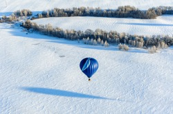 hot air balloons in the sky in winter