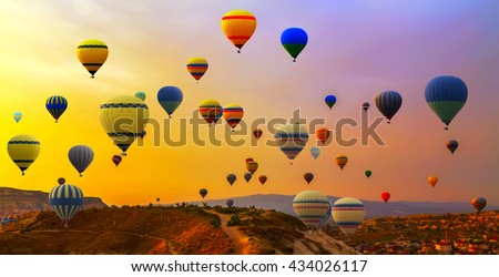 Hot air balloons landing in a mountain Cappadocia Goreme National Park Turkey. #434026117