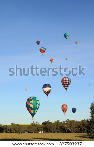 hot air balloons landing in the Avon Valley at the national championships #1397503937