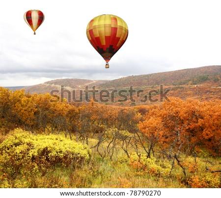 Hot Air Balloons Over Autumn Landscape - stock photo