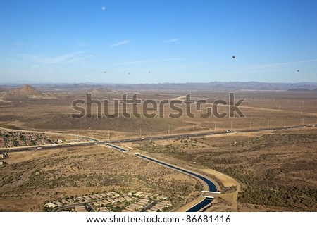 Hot Air Balloons over desert freeway and canal