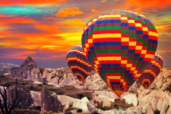 Hot air balloons sky mountain Cappadocia Goreme National Park Turkey.