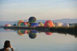 Hot air balloons starting their flight at early morning.