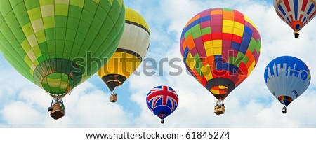 hot air baloons with blue sky background