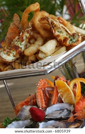 hot and cold seafood on two tier platter at restaurant