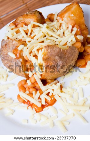 Hot and crispy baked potato stuffed with baked beans and grated cheese