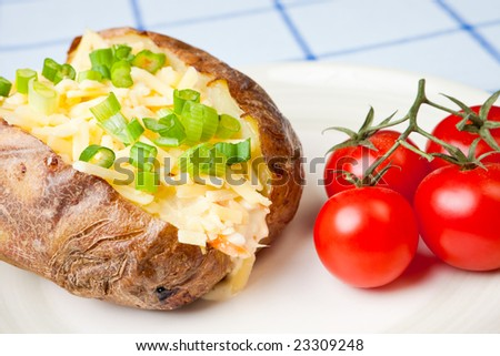 Hot and crispy baked potato stuffed with cheddar cheese and coleslaw