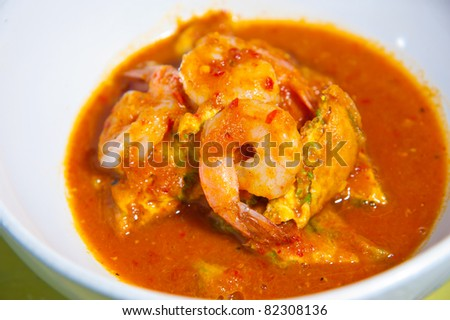 hot and sour curry with tamarind sauce, shrimp and vegetables : Delicious thai traditional food (kang som cha-om koong)
