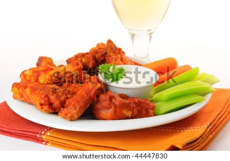 Hot and spicy buffalo chicken wings and crisp vegetables.