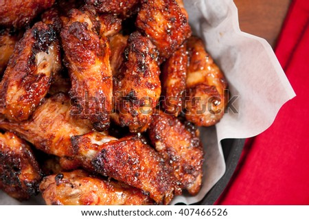 hot and spicy buffalo style chicken wings in a basket #407466526