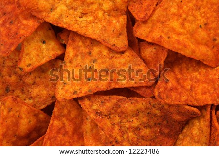 Hot and spicy corn chips. Abstract food textures.