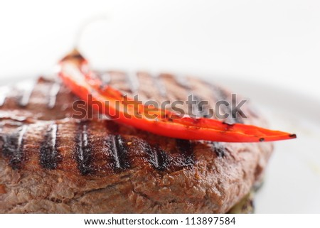 hot and tasty roasted meat on white dish