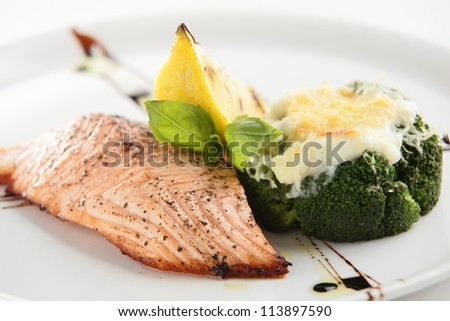 hot and tasty roasted meat on white dish - stock photo