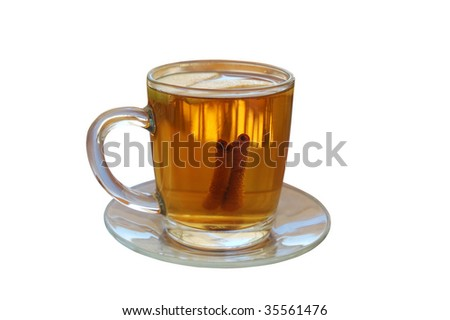 hot apple cider with two slices of apple and cinnamon sticks isolated on white