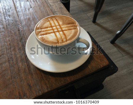 Hot art Latte Coffee in a cup on wooden table . #1016370409